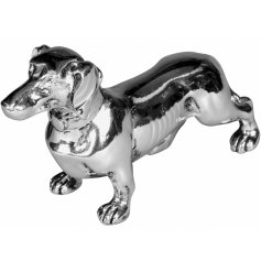 Bring a touch of luxury to any home space or display with this charming little silver dog figure