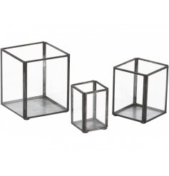 A contemporary inspired set of sized candle holders in a square form