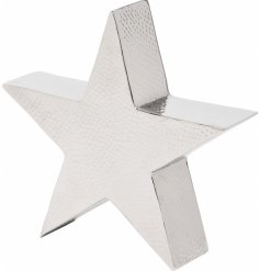 A sleek and simple standing star decoration, coated with a Silver Aluminium tone and finished with a subtle hammered eff