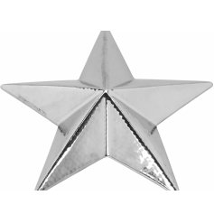 A stylishly simple star shaped decoration, coated with a silver tone and set with a subtle hammered effect