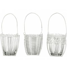 A chic and charming assortment of metal wire tlight holders, each set with its own patterned decal