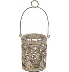 A beautifully Rustic themed metal tlight holder set with a distressed charm and floral pattern feature