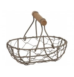 A small rustic wire basket with an added handle feature,