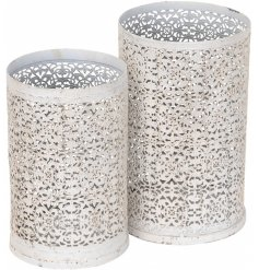 this set of 2 sized candles holders feature a beautiful floral cut pattern and shabby chic inspired decal