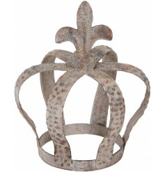 An Antique inspired metal crown decoration featuring an overly distressed charm and tarnished effect