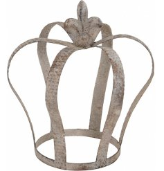 An antique style metal crown with a textured finish. A unique and stylish interior accessory.
