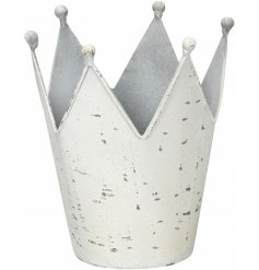A white shabby chic metal crown decoration.