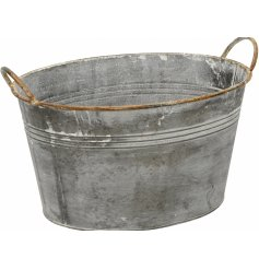 Add character and charm to the home or garden with this rustic galvanised planter.
