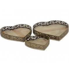 A set of 3 wooden and metal heart shaped trays with a shabby chic finish.