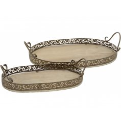 A set of 2 different sized trays with an ornate decorative brown framework and handles.