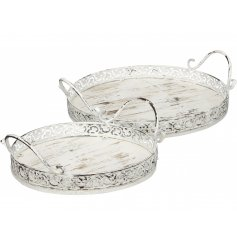 A set of 2 white vintage style round trays. Each has a pretty decorative design and twin carry handles.