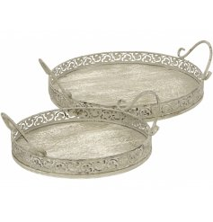A set of 2 wooden and metal decorative round trays with a grey washed finish.