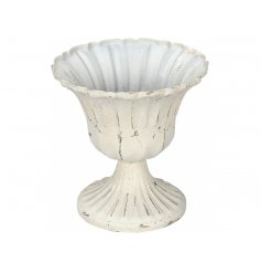 A shabby chic style cream candle holder on stand.