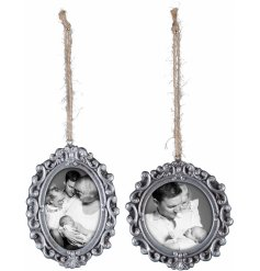 A beautiful assortment of hanging silver picture frames set with an antique inspired surround