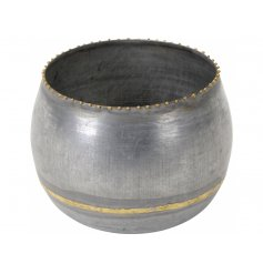 A chic metal candle holder with a decorative gold dot rim and stylish gold decoration.