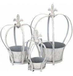 A set of 3 white metal crown shaped planters. A charming and unique garden themed gift.