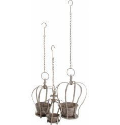 A set of 3 rustic hanging crowns, each with a plant pot. A unique and stylish garden accessory.