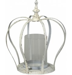 A beautiful vintage metal crown design candle holder with a shabby chic cream finish.