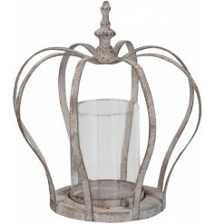 An antique style metal crown candle holder. A stylish decorative accessory with a rustic finish.