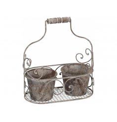An antique style double planter with carry basket.
