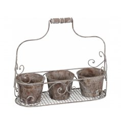 A rustic grey antique style carrier with three plant pots. A chic garden accessory and gift item.