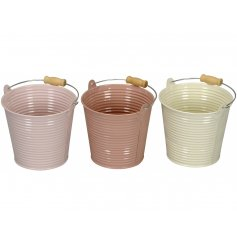 A set of 3 pink pastel buckets with wire and wooden handles. Ideal for planting and storage.