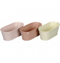 A set of 3 pink pastel oval shaped planters. A chic gift item and decorative accessory.