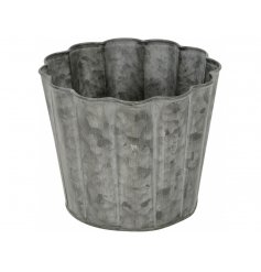 A rustic metal candle holder cup. A charming decorative item for the home or garden.