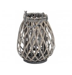 A chic woven lantern with a chunky rope handle and grey washed finish.