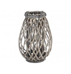 This woven lantern with a rustic, grey washed finish makes a stylish accessory for the home and garden.