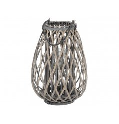 A charming grey rustic lantern with a chunky handle and a grey washed finish.