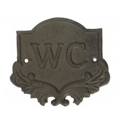 A rustic cast iron WC sign.
