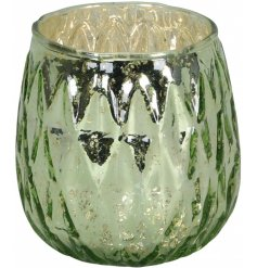 Bring a charming green feature to any home space with this speckle effect glass tlight holder