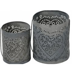 A set of 2 metal candle holders with a pretty heart detail.