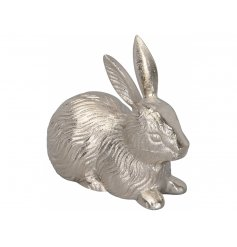 An ornate silver hare ornament with a vintage finish. A lovely, textured decorative surface.