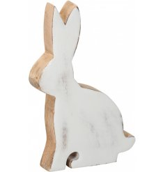 A shabby chic style wooden bunny ornament. A chic seasonal gift item and decoration.