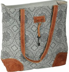 Decorated with a soft grey suedette fabric, this beautifully patterned handbag will tie in with any seasonal outfit