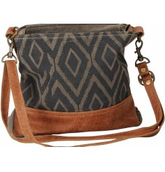 A slouchy styled hobo bag decorated with a grey diamond print