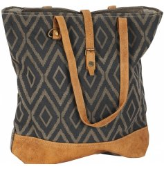 A hobo inspired slouchy handbag featuring a stylish diamond print and faux leather handle finish