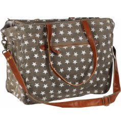 Stay on trend with this slouchy canvas bag with a star print and brown handles.