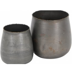 A set of 2 beautiful, on trend metal vases with a gold beaded rim and tarnished surface texture.