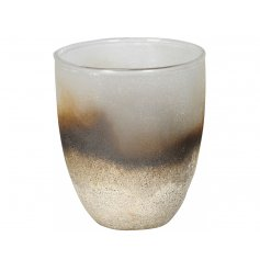 A stunning rough luxe candle holder with a fine textured surface and rich gold colourings.