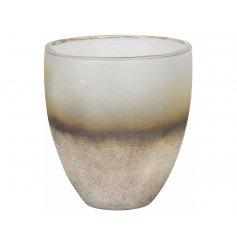 A stunning rough luxe candle holder with a textured surface pattern and gold colourings.