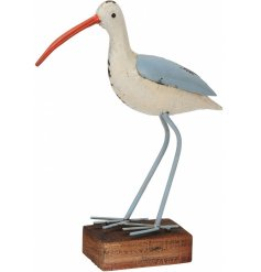 A blue and white metal seagull ornament with wooden base. A seaside themed decoration for the home.