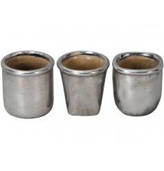 A mix of 3 mini silver vases in different shapes. Each has a rustic silver finish.