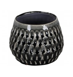 A richly glazed black vase with a decorative contemporary pattern. A chic interior accessory for the style savvy.