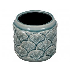 An attractive blue glaze vase with a decorative coral reef pattern. A charming interior accessory.