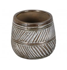 A stylish bronze vase with a contemporary surface pattern. A rough luxe item for the home.