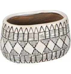 A super stylish oval vase with a geometric design. A must have item for the style savvy.
