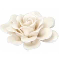 A delicate ceramic rose decoration in a charming white tone, a perfect accessory for any home space